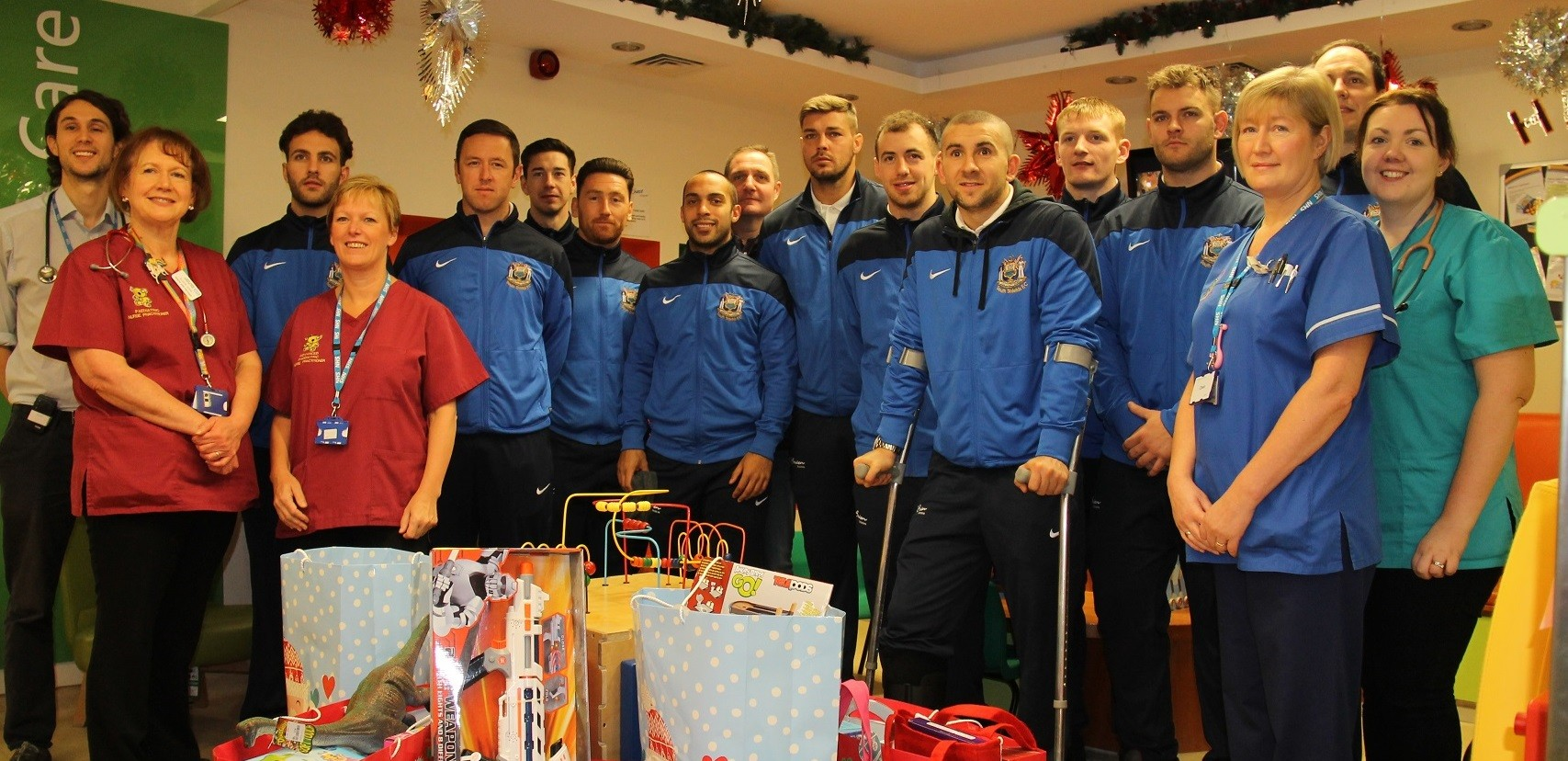 VIDEO: Players deliver presents to youngsters at hospital
